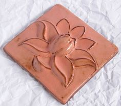 Hand carved relief tile.