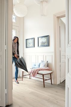 Quick-Step Laminate Flooring - a water-resistant laminate that looks like hardwood and is available in wood and painted finishes. Because it's water-resistant, it's a great option for kitchens, bathrooms and entryways - via WoonBlog