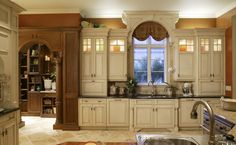 """Arch over my sink window and the lighting above the cabinets are just the dramatic look that takes me back to the """"old world""""."""