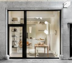 Simple, clean shop front. The giant windows are awesome, the black window frames set a perfect border for a person to try to look past.