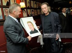 Max Klimavicius, Manager of the historic Sardis Restaurant presents actor Christopher Walken with his caricature during an unveiling ceremony to unveil the Christopher Walken caricature at Sardi's on April 6, 2010 in New York City.