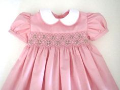 This lovely little pink dress features delicate white smocking with gorgeous pink rose bud clusters and green leaves. Baby Girl Pink Dress, New Baby Dress, Little Pink Dress, Baby Girl Frocks, Frocks For Girls, Dress Girl, Girls Smocked Dresses, Little Girl Dresses, Flower Girl Dresses