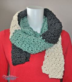 This over-sized free crochet scarf pattern is perfect for cool fall nights and blustering winter days alike. The three tones add visual appeal, though this scarf would also look great in one color. The stitches chosen for this free scarf pattern are easy yet provide wonderful texture for a sophisticated look.