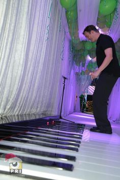All of your guests will have a great time composing a tune as they enter your party on this giant keyboard walkway that plays a melody as you walk over the keys.