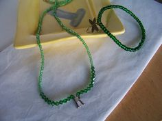 "Necklace has Green Seed Beads and Swarovski Beads with the Letter ""R"" by kaysjewelrydesign on Etsy"