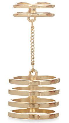 Bague composée de plusieurs anneaux reliés par du métal ACCESSORIZE, vu dans Closer, à retrouver sur Selectionnist.com
