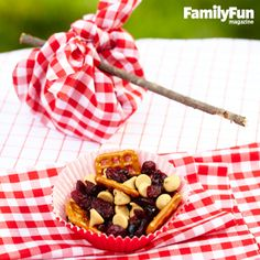 Serve PB and J to Go: Keep kids energized with a snack that celebrates the wandering life — and the flavors of a classic sandwich. Combine 25 pretzel pieces with a 1/2 cup each of peanut butter chips and dried cranberries. Place the mix in cupcake liners, then set each on a 14-inch fabric square and tie the corners together. If you like, insert a stick into the knot for carrying the bundle (or bindle, as dedicated wanderers call it) to the perfect snack spot. Makes 5 servings.