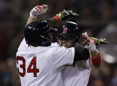 Boston Red Sox's David Ortiz (34) celebrates with Shane Victorino..