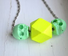 NEON Hand Painted Wood Skulls and Geometric Bead Necklace on Chain. $15.00, via Etsy.