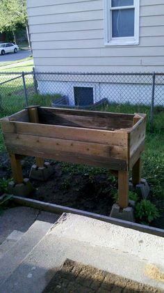 Raised garden from re-purposed materials.