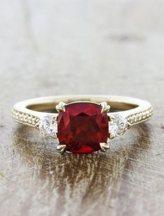 Delexie: Three-Stone Cushion-Cut Ruby Engagement Ring with Pave by Ken & Dana Design. #customengagementring #uniqueengagementrings #rubyring