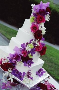 white Cake with purple variety of flowers #cake  #weddings