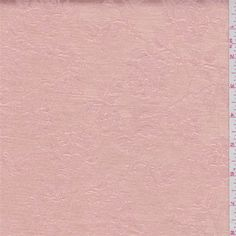 Solidpeach with a rosedesign. This light/medium weight rayon/polyester fabric has good drape.Compare to $10.00/yd