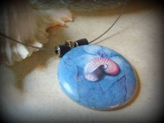 https://flic.kr/p/co4B4E | Ocean Blue | Polymer clay pendant made using a toner transfer technique. This was an entry for the Polymer Clay Smooshers Monthly Challenge: OCEAN.