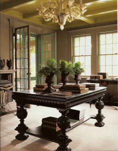 In this library, a white Jacobean-style table is painted black, making an elegant, functional library table. — Martha Stewart Living, February 2003 Previous Post Next Post Tables Tableaux, Martha Stewart Home, Library Table, Library Room, Interior And Exterior, Interior Design, Elegant Living Room, Lily Pond, Decorating With Pictures
