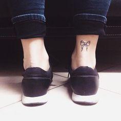 bow tattoo on foot