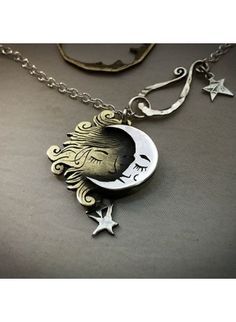 by the Hairy Growler Handcrafted and recycled sterling silver shillings Sun and Moon necklace