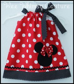 What a cute little dress this turned out to be , perfect for any little Minnie Mouse fan and for a trip to Disney. This dress was created with a red polka dot fabric and paired with a black and white polka dot the dress features an appliqué Minnie silhouette . U Please leave size needed in mess...