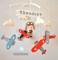 Airplane baby mobile Nursery mobile Cot mobile Crib mobile Felt Pilot Vintage plane Baby mobile boy Airplane nursery decor Baby shower gift Personalized baby boy gift 100 % wool felt Welcome to «minimez»♥ This lovely baby mobile with vintage airplanes and pilot theme is perfect for a baby boy nursery. Hand-sewn with attention to details from the 100% merino wool felt of highest quality. Each plush element is filled with hypo-allergenic polyester stuffing. You can choose this mobile with…