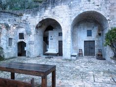 Here you'll find cave hotels in the sassi of Matera, a town in southern Italy famous for its district of cave houses and churches dug into the rock.
