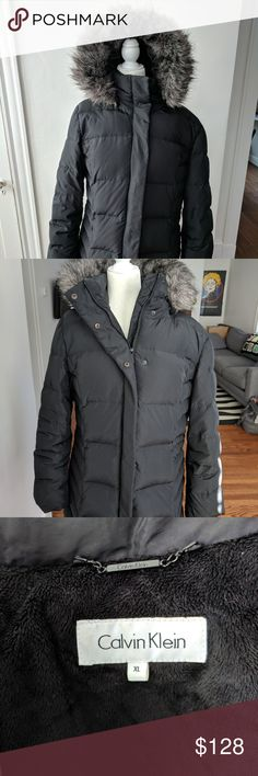 Calvin Klein Puffer Jacket with Faux Fur Hood The cozy down of this faux-fur-trimmed puffer coat from Calvin Klein ensures you stay warm in all conditions.  Zipper front with snap-button overlay Fully lined Zip pockets at hips Removable hood with faux-fur trim and adjustable strings Quilted; inner vest Shell & lining: polyester; faux fur: acrylic/modacrylic/polyester; fill: down/waterfowl feathers Machine washable Calvin Klein Jackets & Coats Puffers