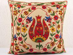 Uzbek Suzani (Anatolian inflences)  https://www.etsy.com/listing/177632252/handmade-suzani-pillow-cover-usp114