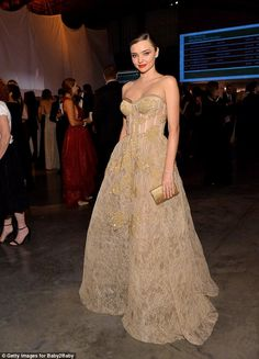 Belle of the ball: The Australian model looked simply sensational in top-to-toe gold...