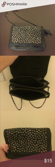 Cross body black studded bag Chic black studded small bag with black chain. Can be worn as cross body, on one shoulder, or held as a clutch with chain tucked in. Has 2 spacious pockets for belongings. Great for a night out. Minimal wear and tear. GAP Bags Crossbody Bags
