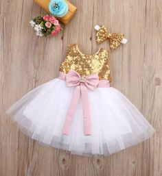 Sequin Baby Girl Tutu Dress & Headband - Ready to Ship in 3-5 Business Days Gold Sequin Pink Bow Knee Length Lace Baby Girl Tutu Dress Perfect for birthday, wedding, photo shoot or any special occasion. Material: Tulle mesh, Sequin, Lace Available from 6 months - 9 years