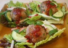 Vietnamese Meatballs with Lettuce Wraps. Delicious little morsels flavored with cilantro, mint, lemongrass, and ginger.  Serve with sweet chili sauce for dipping or drizzling.  A great low carb appetizer or dinner entree.