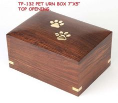 Pet Cremation Urns~ Wooden Pet Urns   We are a leading manufacturer, supplier and exporter of Wooden Pet Urns. The unmatched quality has attracted various national as well as international clients to place repeated orders. Wooden Pet Urns is a exclusive designer box made of fine wood and people using this to keep memories of his pet animals after their death.""