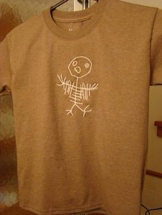 I digitized my five year old grandson, Spencer's, drawing and stitched with glow in the dark thread.  Sharyn