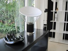 The game room also featured Flos' Taccia Table Lamp, another classic design from the Castiglioni brothers.
