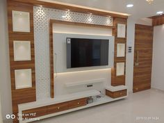 TV unit with acrylic cutting & mirror tv unit Modular TV Unit Tv Unit Furniture Design, Tv Unit Interior Design, Interior Ceiling Design, House Ceiling Design, Ceiling Design Living Room, Tv Wall Design, Interior Modern, Modern Tv Room, Modern Tv Wall Units