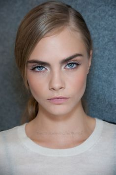 Cara Delevingne // bold brows. white eyeshadow, long lashed, pink lips #beauty #makeup