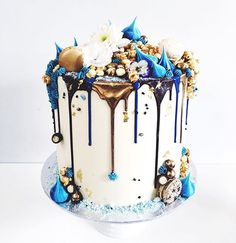 Marguerite Cakes. Blue, chocolate and gold drip!