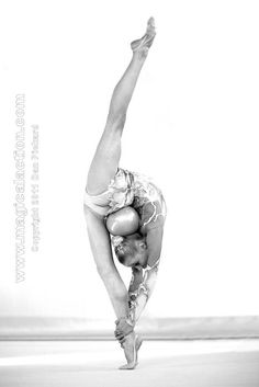 Rhythmic gymnastics is crazy, not only the strength, but crazy flexibility too! Even her toes are perfect ! lol   I have mad respect for this girl, she trains like crazy!