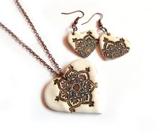 Lotus heart necklace and earrings, faux ivory, lotus mandala, polymer clay jewelry, Valentine's day gift for her. $36.00, via Etsy.