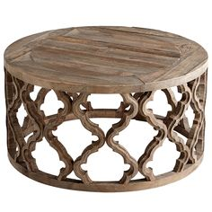 """A modern furnishing with a global vibe, the Sirah coffee table provides a glamorous surface to living rooms and sitting areas. A carved geometric pattern elegantly serves as the round base, topped with a rustic wood piece. 15.75""""H x 30.5"""" Diameter. Wood. Black Forest Grove finish. Wipe with soft, dry cloth to clean."""