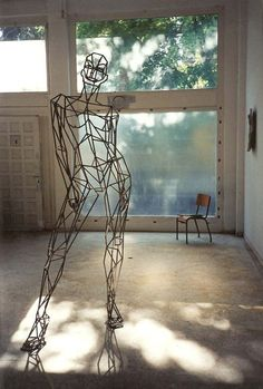 Stainless steel #sculpture by #sculptor Toby Short titled: 'virtual woman (Caryatid stainless Steel female statues)'. #TobyShort