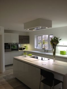 AlnoStar Vetrina kitchen with Corian white worktops.  Designed by Jonathan Kemp  www.codelectrical.co.uk