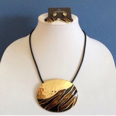 Necklace & Earrings Set This beautiful set is sure to make a statement.  The hammered gold, black and brown on the necklace is an amazing combination.  This set has never been worn.  No tag on the necklace, but tag shown for the earrings in picture #4. Chico's Jewelry Necklaces