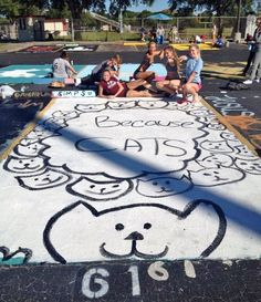 High school seniors customize assigned parking spots with clever murals: Because cats? Because cats.