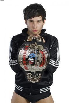 Professional wrestler known for his time with the major WWE and TNA brands. He debuted in the WWE in August 2016 in the up and coming division of crui Noam Dar, Men's Wrestling, Andy Biersack, Professional Wrestling, Mma, Superstar, Christmas Sweaters, Champion, Tv Shows