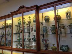 The cabinets full of Della Robbia Pottery in the Williamson Art Gallery