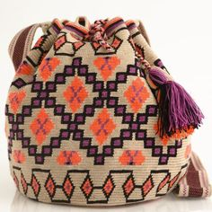 Mochila of August 2014 Fair-trade Handmade Wayuu Boho Bags have amazing patterns and bright colors to cinch your summer look. Mochila Crochet, Tapestry Crochet Patterns, Ethnic Bag, Tapestry Bag, Boho Bags, Bohemian Bag, Crochet Purses, Knitted Bags, Handmade Bags