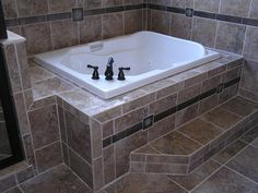 tiled bathrooms with jacuzzi | Macale Builders, Inc. | Custom Home Bathroom Kitchen remodels