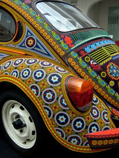 A beaded VW Beetle.