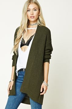 An open-knit cardigan featuring a longline silhouette, dropped shoulders, long sleeves, ribbed trim, and an open front.