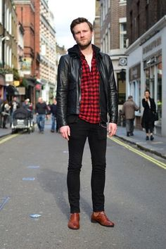 Shop this look on Lookastic:  https://lookastic.com/men/looks/bomber-jacket-hoodie-long-sleeve-shirt/14183  — White Crew-neck T-shirt  — Red and Black Gingham Long Sleeve Shirt  — Black Leather Bomber Jacket  — Black Hoodie  — Black Skinny Jeans  — Brown Leather Chelsea Boots